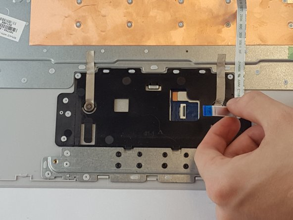 Image 3/3: Disconnect the TouchPad cable by pulling it away from the connector.