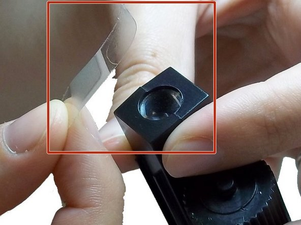 Apply tape to the lens for safe removal and prevention of injury.