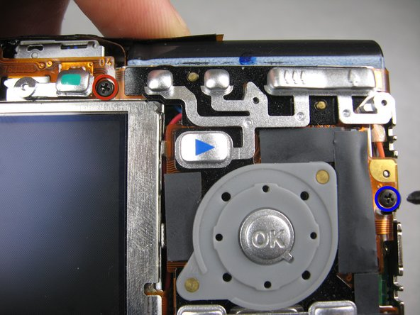 Flip the camera over to the backside and remove screws indicated: