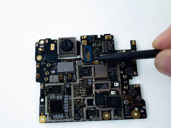 Use the pointed end of a spudger to lift up and disconnect the rear camera press-fit connector.