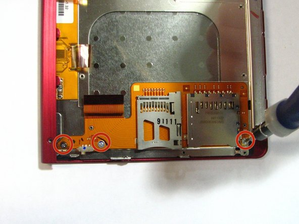 Using a Phillips head screwdriver, remove the three 1.4 mm screws located on the SD/memory card holder.