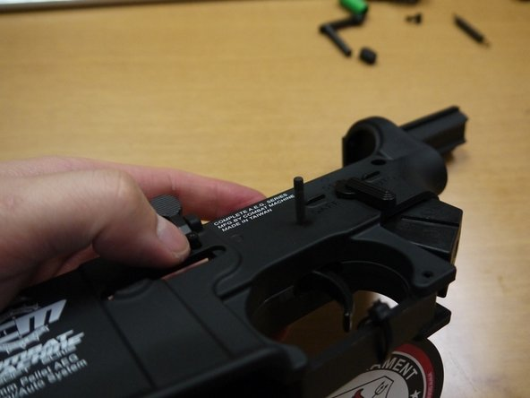 Image 2/3: Insert the mag catch arm in its slot.