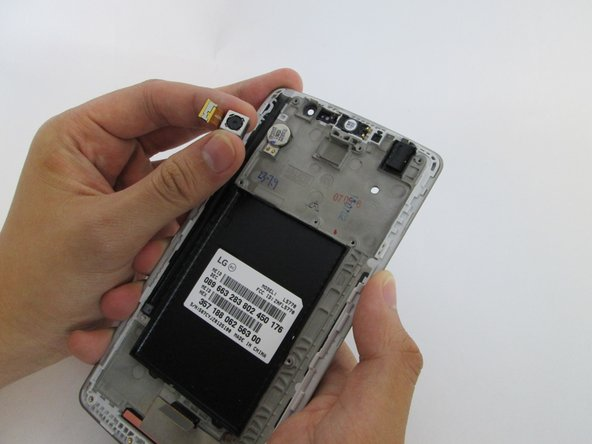 Image 2/2: The rear camera will have an adhesive so you will have to carefully add pressure while lifting up.