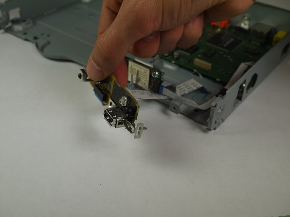 Carefully pull the port board free from the Blu-Ray player.