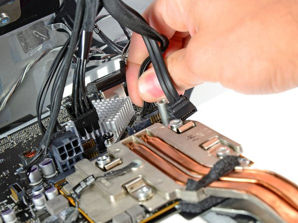 Pull the hard drive power cable connector out of its socket on the logic board.