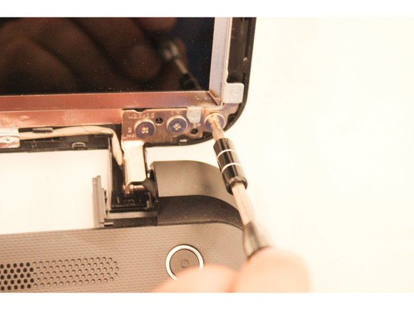 You will need to hold the screen upright so that it does not fall while removing the final three screws.