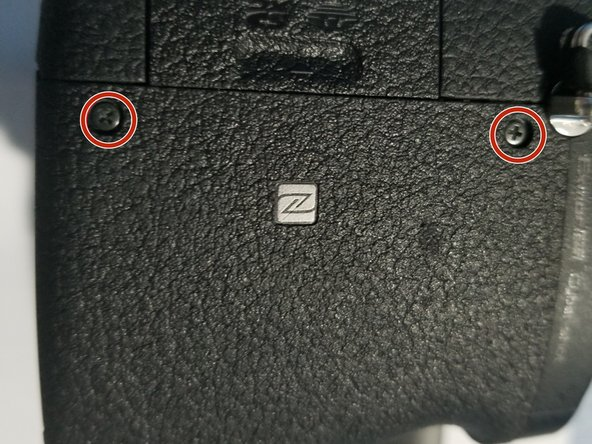 Remove the two 0.7mm screws that secure the right side of the camera.