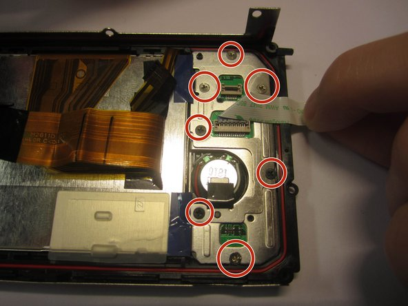 Remove all seven screws (4.1mm) from the metal plates (#000)