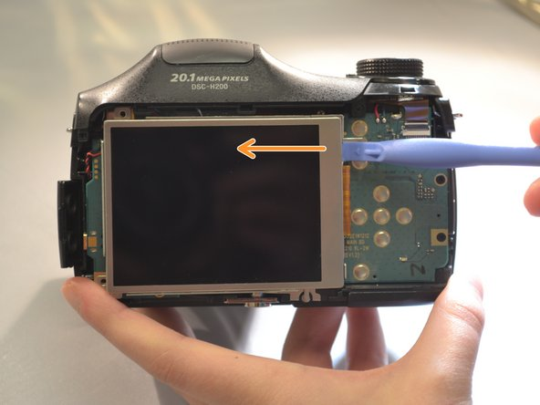 Using the blue plastic opening tool remove the LCD Screen from the motherboard.