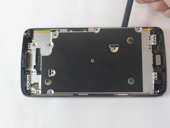Remove the interior metal covering using the plastic opening tool.