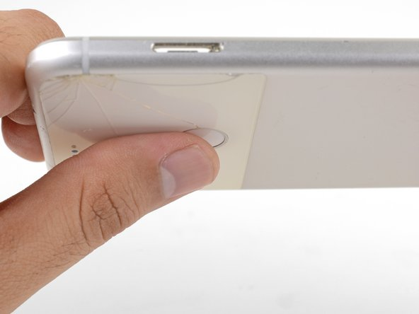 Position your thumb over the fingerprint sensor and push firmly until the sensor pops out of its indention.