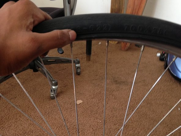 Finish by placing the bike tire back on the the frame, while making sure that no fold or creases form in the tube.