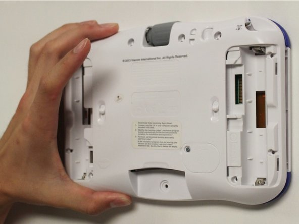 Carefully remove the rear panel from the front panel of the device.