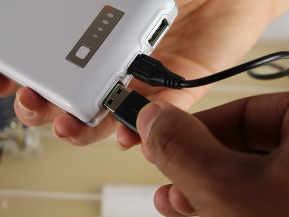 Insert the USB cord into either of the two USB ports on the battery.