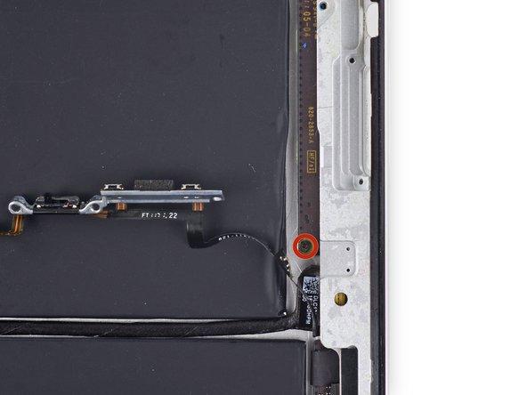 Retirez la seule vis cruciforme #000 de 2 mm de l'extrémité inférieure de la carte des composants supérieurs.