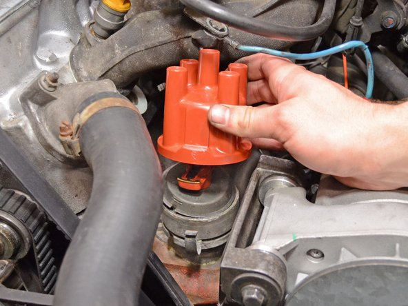 Image 2/2: Remove the old distributor cap.