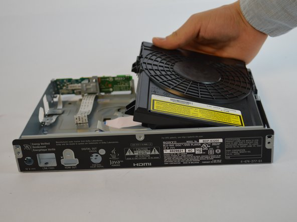 Lift the disk drive  off of the device