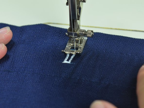 Sew up the second side of your buttonhole, stopping at your top mark.