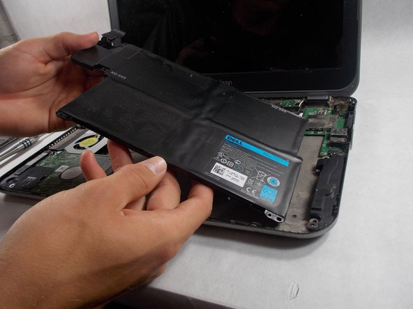 Remove the  screws surrounding the battery and unplug the cable in the top left corner to then remove the battery.