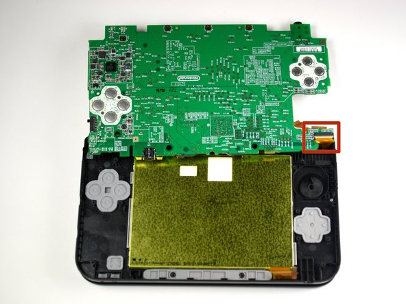 Image 2/2: Gently flip the motherboard over the top side.