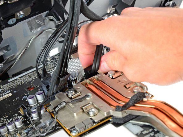 Being careful not to damage the socket on the logic board, gently pull the hard drive SATA data cable straight out of its socket on the logic board.