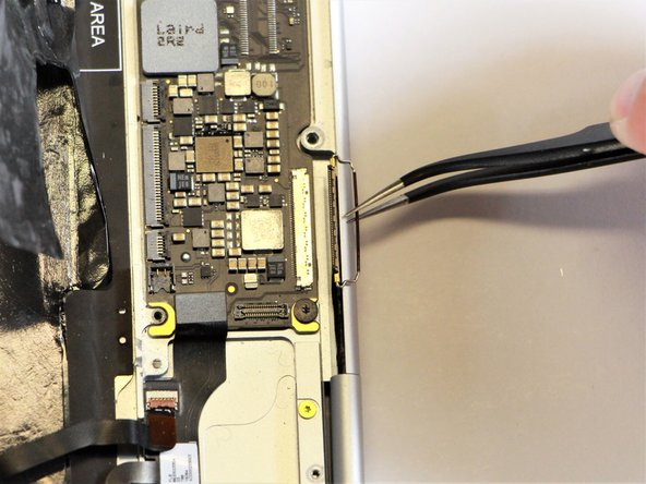 Disconnect the large flat cable from the motherboard by gently pulling on the latch using the needle-nose tweezers.