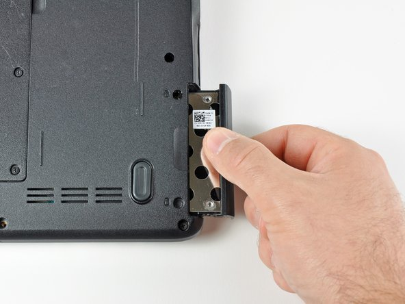Image 2/3: Slide the hard drive and hard drive tray out of the laptop.