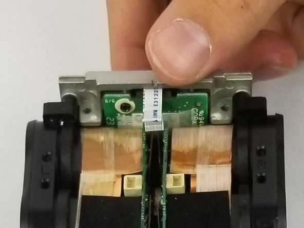 Lift the mic connector out of the base of the device.
