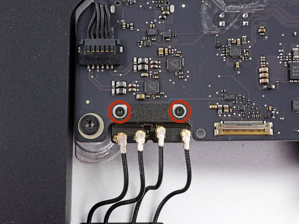 Remove the two 3.2 mm T5 screws securing the AirPort/Bluetooth card to the logic board.