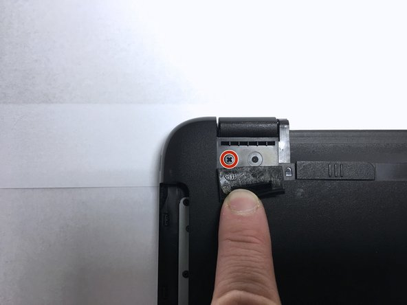Remove the screws located beneath both rubber feet.