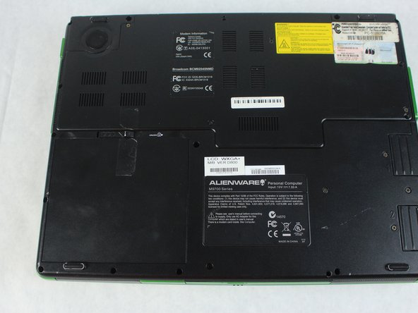 Turn laptop over so that the bottom of the device is facing upward.