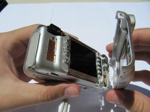 Remove the rear camera casing.