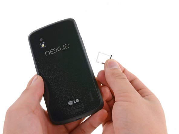 Image 2/2: Phew, that was exhausting! With the Micro SIM card tray out, the Nexus 4 slims down to a scant 138.8 grams.