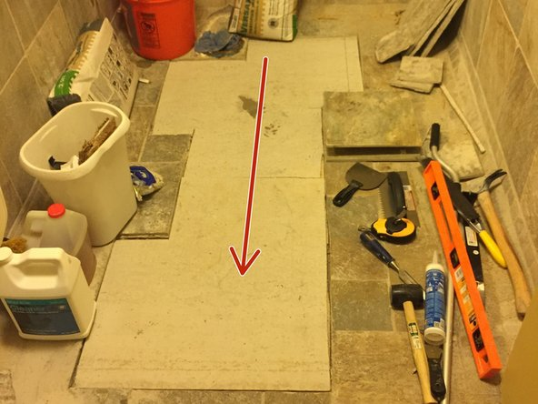 When placing tile, be sure to start from the back of the room so that you do not work yourself into a wall or corner.