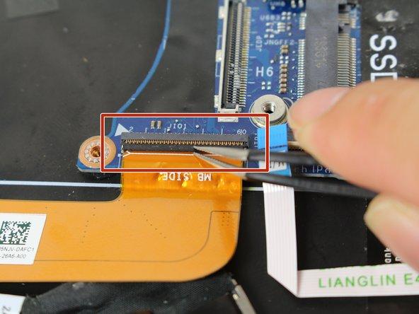 Use tweezers to flip open the ZIF connector.