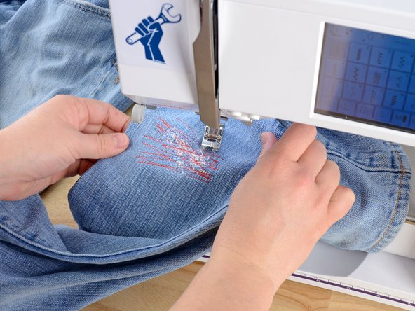 Be sure that there is only one layer of fabric (plus the rectangle) between the sewing machine and the needle, or else you will sew the pant leg shut.