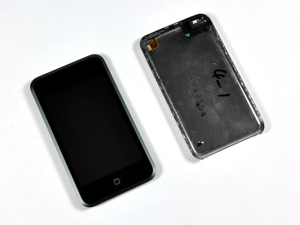 Image 2/3: The front and back of the iPod should now be completely separated.