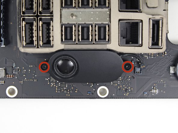 Remove the two 3.2 mm T4 Torx screws securing the speaker to the IO board.