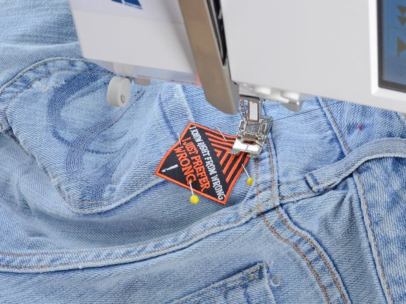 Be sure you only have one layer of the jeans between the needle and the sewing machine arm, or you will sew the pants shut.