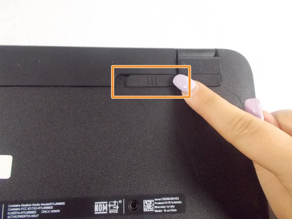 Remove battery by sliding the battery lock.
