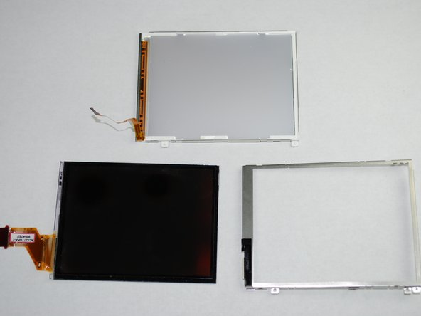 The LCD screen and housing should now be in three pieces: