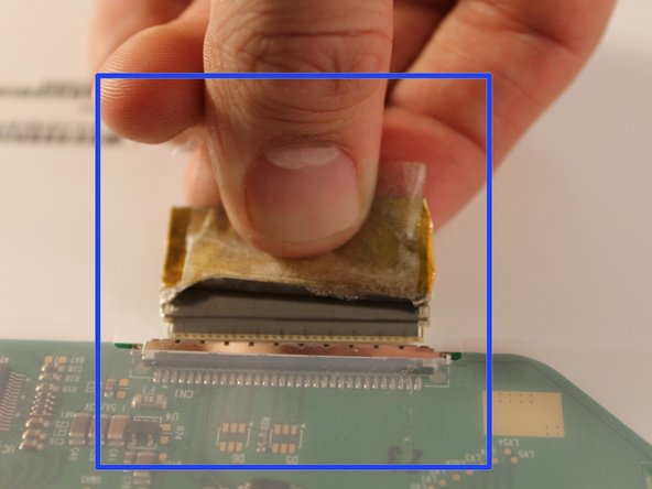 Image 3/3: Carefully remove the ribbon cable by pulling it out of it's socket.