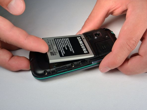 Image 1/1: Press the battery toward the audio jack while lifting upward and away from the phone.