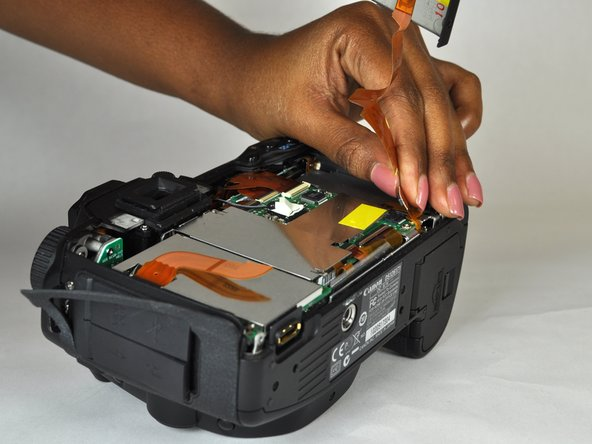 Image 2/2: Separate the rear case from the camera.
