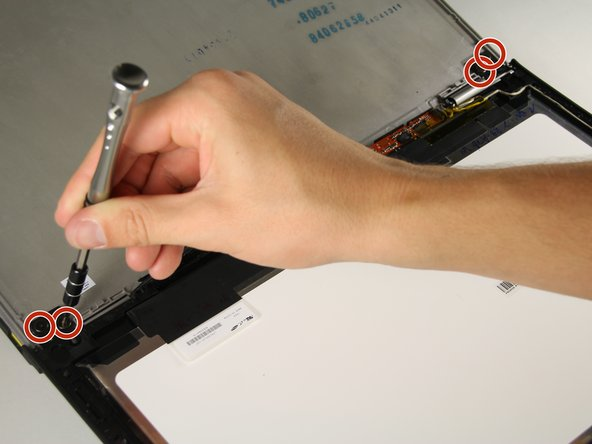 "Remove the four 1/8"" screws using a Phillips #00 screwdriver from the hinge on either side of the laptop."
