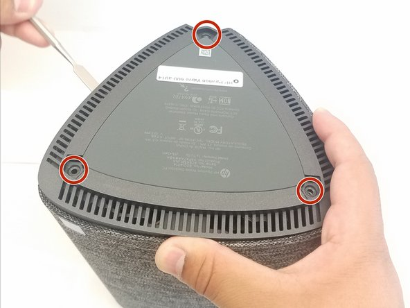 Turn over computer and remove the rubber feet.