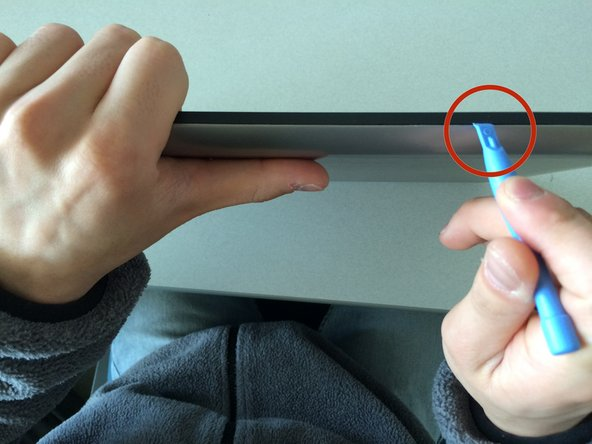Take the pry tool and pry open the backing of the tablet around all four sides and pull off back.