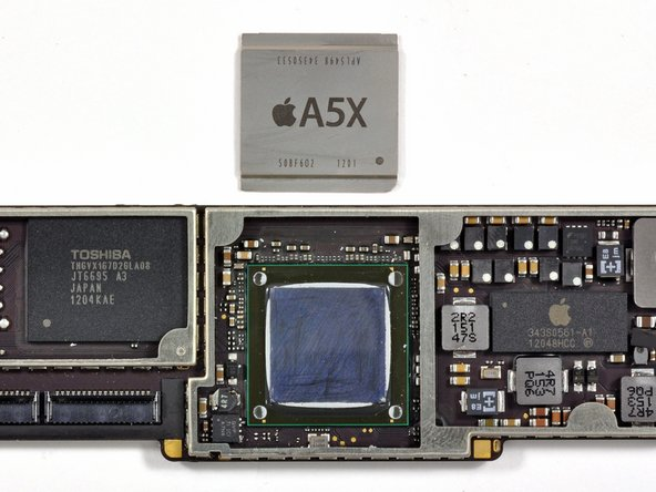 Image 1/1: Underneath the cover we find the A5X processor flip chip mounted onto the carrier PWB.