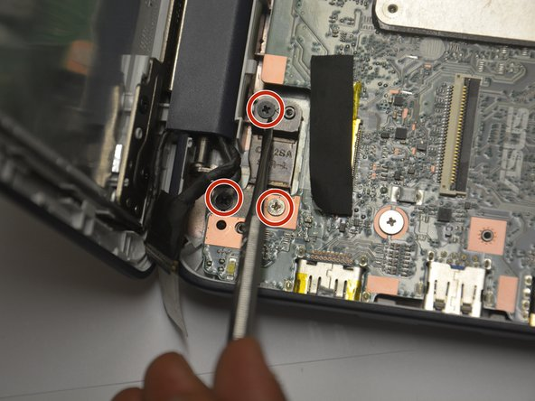 Remove the four black and 1 gold (for a total of five) Phillips #1 3.0 mm screws from the display support.  There are two screws on the right side and three on the left.