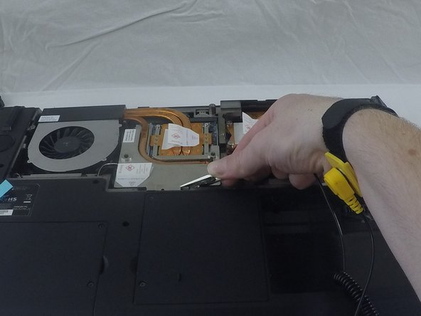 Image 1/1: Put on the electrostatic wrist strap and attach the alligator clip to a sturdy piece of metal inside the case.